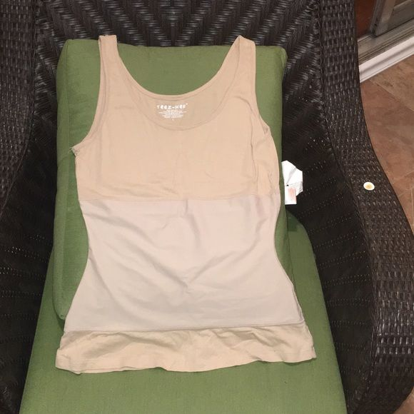 Tank for layering with stretchy center panel Tan tank with stretchy center great for layering. Pillow is 22inches long and 17 inches wide for reference. Tops Tank Tops