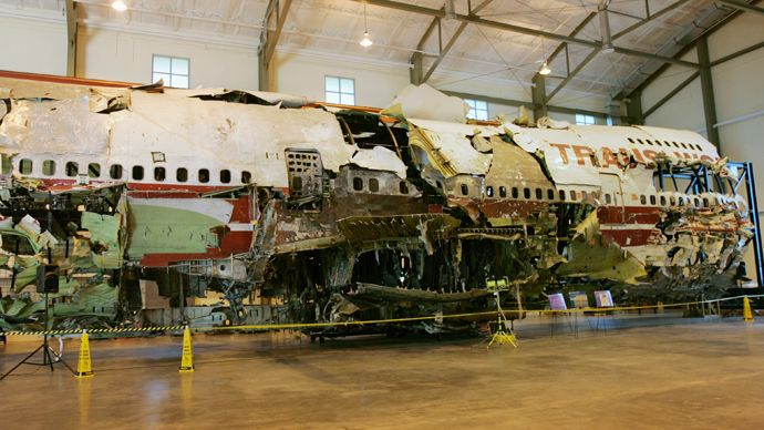 Former officials involved in the investigation of TWA Flight 800 explosion claim that there was a cover up and that there was an outside explosion that caused the plane to break up.