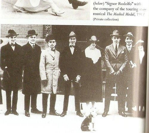 Rudolph Valentino (right) stood.