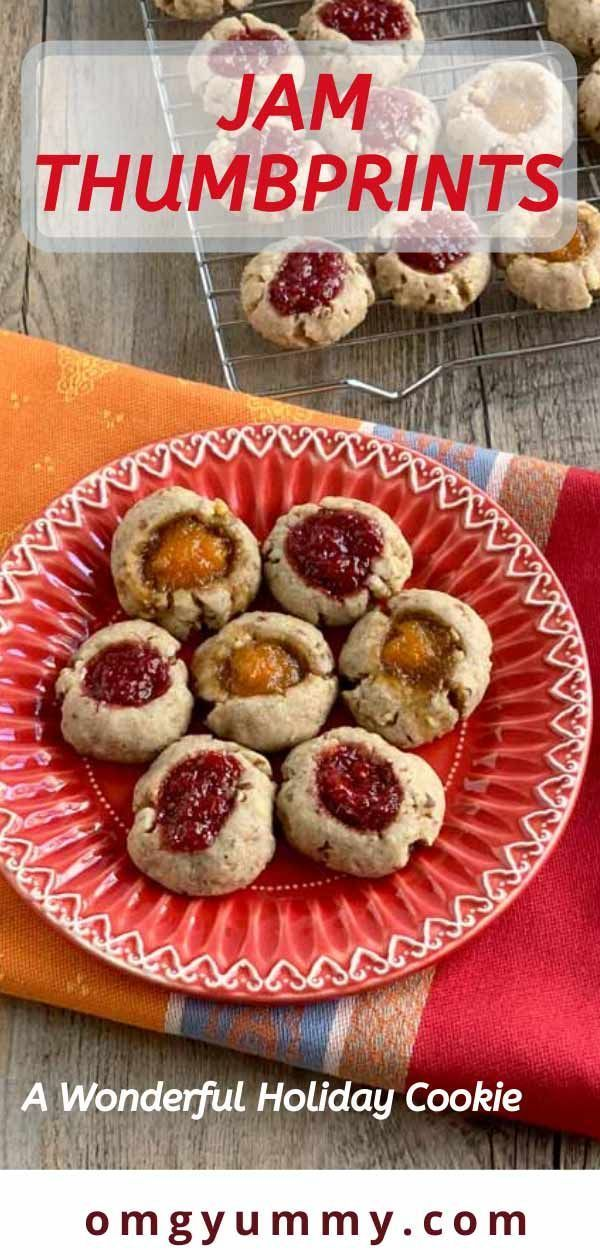 Jam Thumbprints #jamthumbprintcookies Jam thumbprint cookies are a simple, versatile and really tasty holiday cookie. In fact, why wait for the holidays - these are delicious and easy to make all year round. The dough in this version is half flour, half pecans and spiced with a bit of cinnamon and other warm spices of your choosing. Fill with homemade jam or your favorite store-bought versions. Minimal sugar and effort yield maximum flavor! #jamthumbprints #cookies #holidaycookies #homemadejam # #jamthumbprintcookies