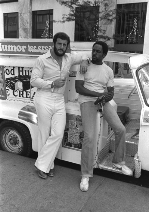 Defensive endLyle Alzado and receiver Reggie Rucker stand in front of a Good Humor truck sampling ice cream in downtown Chicago.