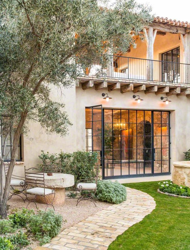 Photo of Mediterranean-style dream home with rustic interiors in the Arizona desert #with…