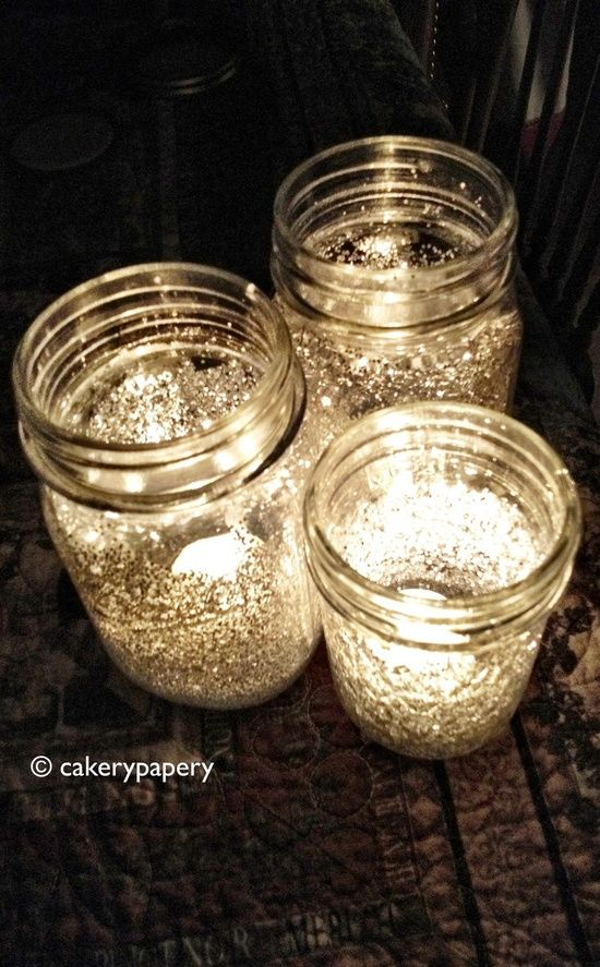 Add water to Elmer's glue and brush inside of mason jar. Put glitter inside of the jars, and roll/spin the jar around until the glitter coats the sides. Add a tea light after it dries, and voila!