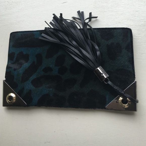 Henri Bendel calf hair clutch w leather tassel Sophisticated and stylish Henri Bendel clutch made of calf hair. Metal triangles on corners are slightly tarnished. Barely used, great condition. Inside like new! henri bendel Bags Clutches & Wristlets