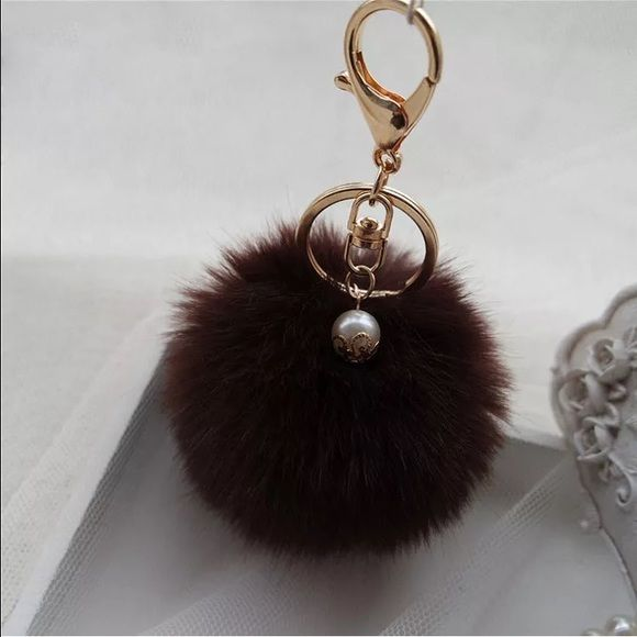"""Cute Brown Faux Rabbit Fur Pom Pom Key Chain This listing is for 1 New Dark Brown Faux Rabbit Fur Trendy Pom Pom Key Chain Faux Rabbit Fur  Metal Hardware Approximately 5.5"""" Length X 3.5"""" Wide I also have Ⓜ️ercari- click on my webpage - use code ZWJFDW to sign up and get $2 to use towards your first purchase Accessories Key & Card Holders"""