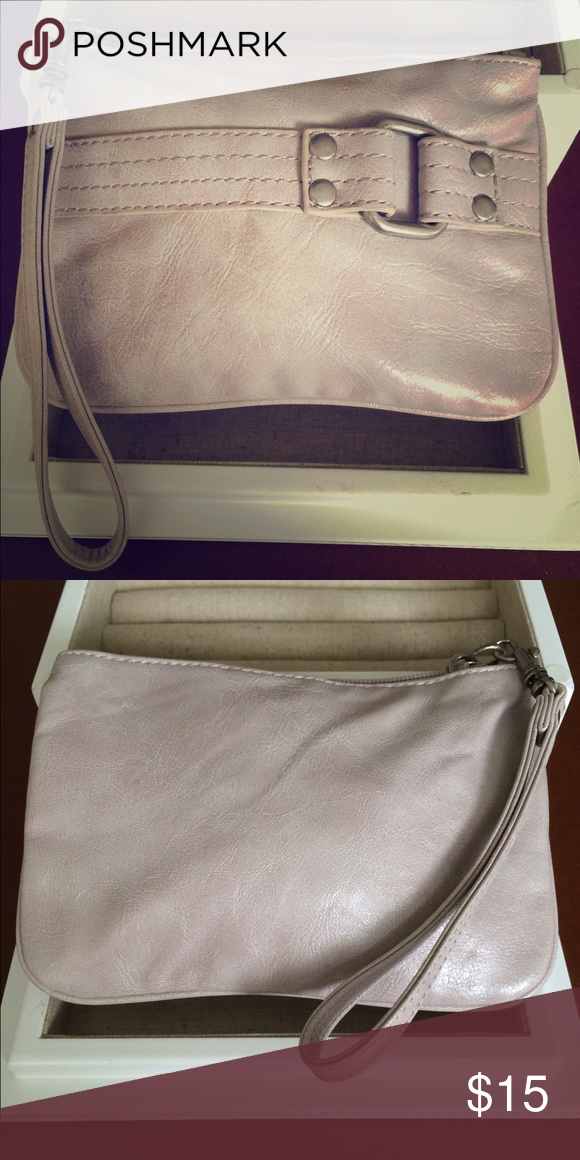 Express wristlet Light pink Express wristlet with cute bucket detail. In new condition, only used a few times Express Bags Clutches & Wristlets