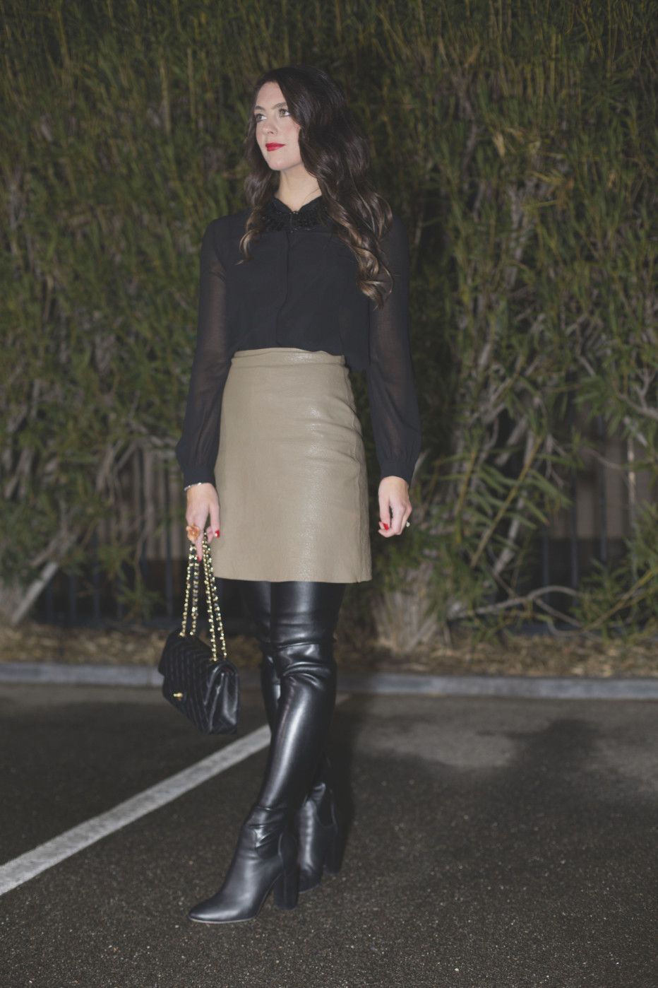 b9892869be966 Brunette amateur in gray leather skirt sheer top and black thigh boots