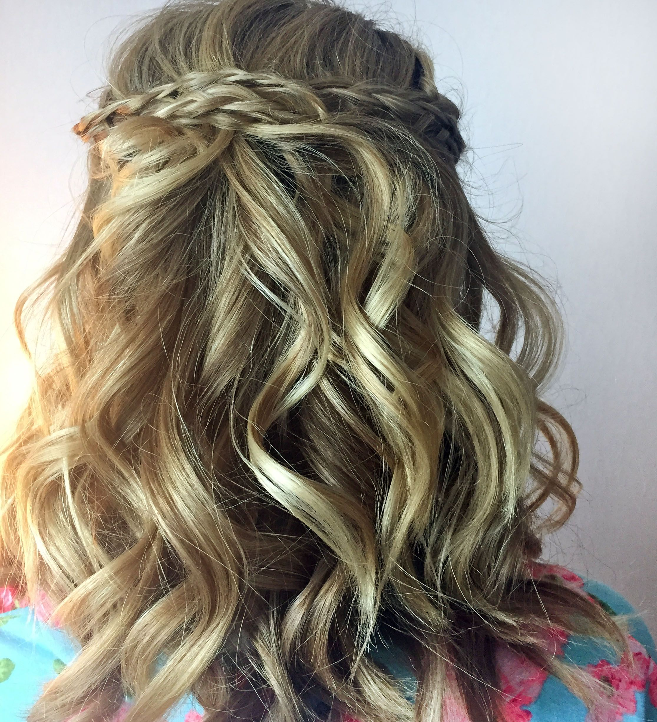 Braided and curled bridal hair style by Melissa