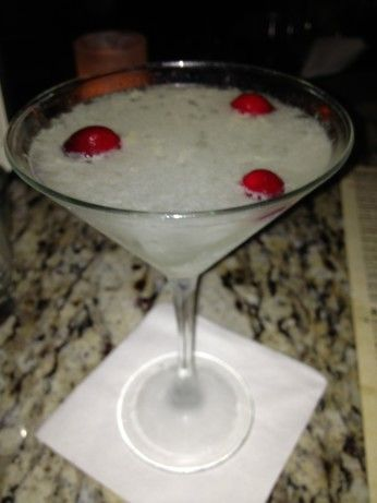 Blue Cosmopolitan ~ 4 Parts Absolut Citron 3 Parts White Cranberry Juice 1  Part Blue Curacao