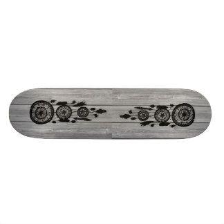 Hipster vintage black dreamcatcher on gray wood skateboard decks