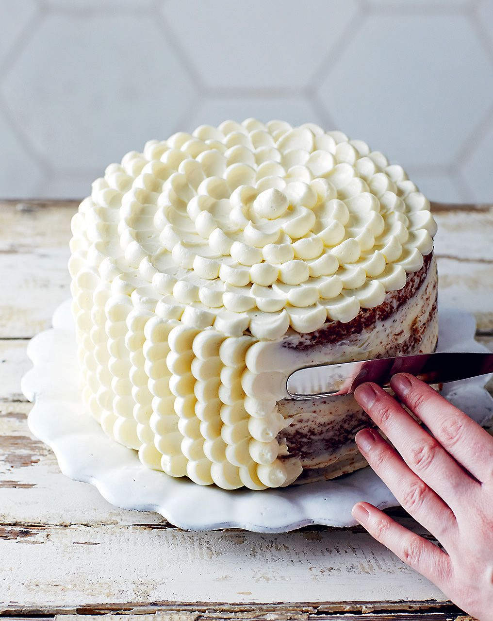 How to pipe a scalloped buttercream cake recipe from Decorated by April Carter | Cooked