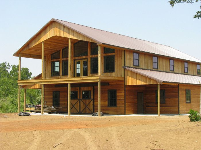 Gorgeous pole barn home two story home two story porch for Barn cabin plans