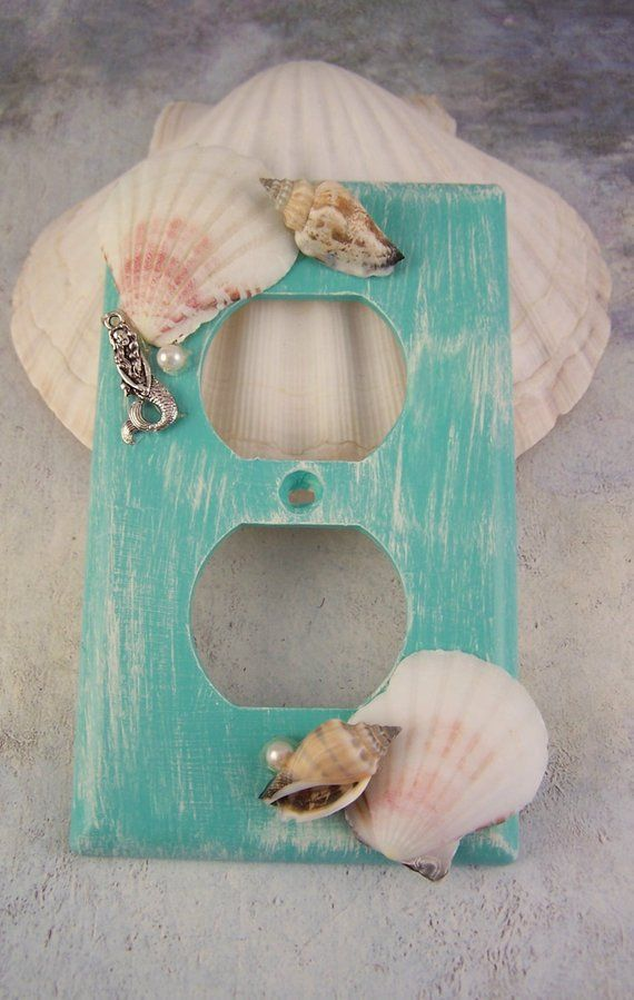 Mermaid Switchplates, Mermaid Decor, Mermaid Switch Plate Covers Mermaids, Mermaid Bedroom Bathroom, Mermaid Nursery, Beach Home Decor Walls #mermaidbedroom Description: This is a Gorgeous Mermaid Sea Shell Switch Plate Cover Set.  You get the 2 plates. You get a light switch plate and a electrical plate.  Hand Painted a Turquoise and Ivory Distressed Look. They are decorated with Gorgeous Sea Shells, Mermaids and Pearls!!! They are so Pretty!  They will make any room look Fantastic.  Great for #mermaidbedroom