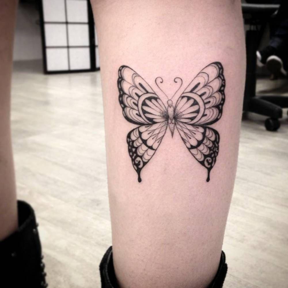 Calf tattoo of a butterfly by Ivy Saruzi. Tattoo Artist: Ivy Saruzi