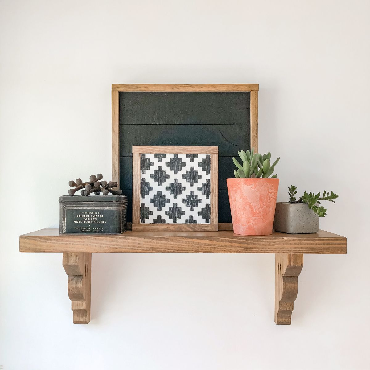 Hanging + styling a shelf can be challenging but it doesnt have to be! Watch our IGTV for a hanging hack. #shelves #simplehomedecor #modernfarmhousedecor