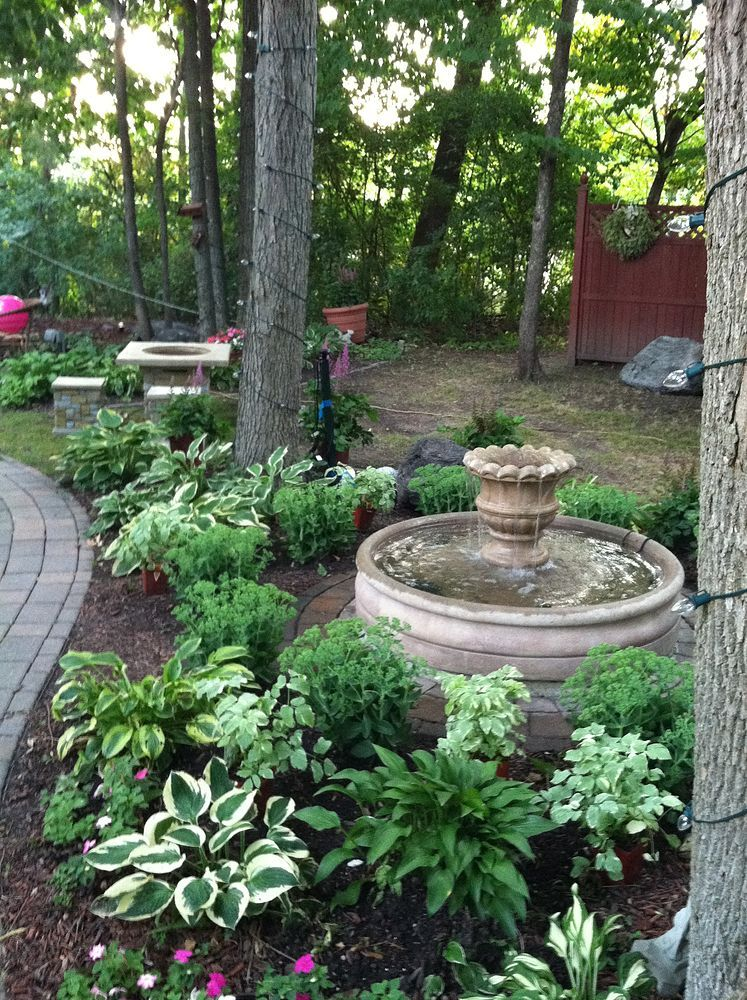 This is one of many favorite sitting spots in our backyard ...