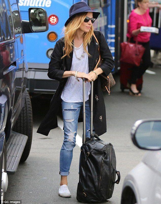 fd12d85b277e folded jeans + tennis shoes  chucks  converse