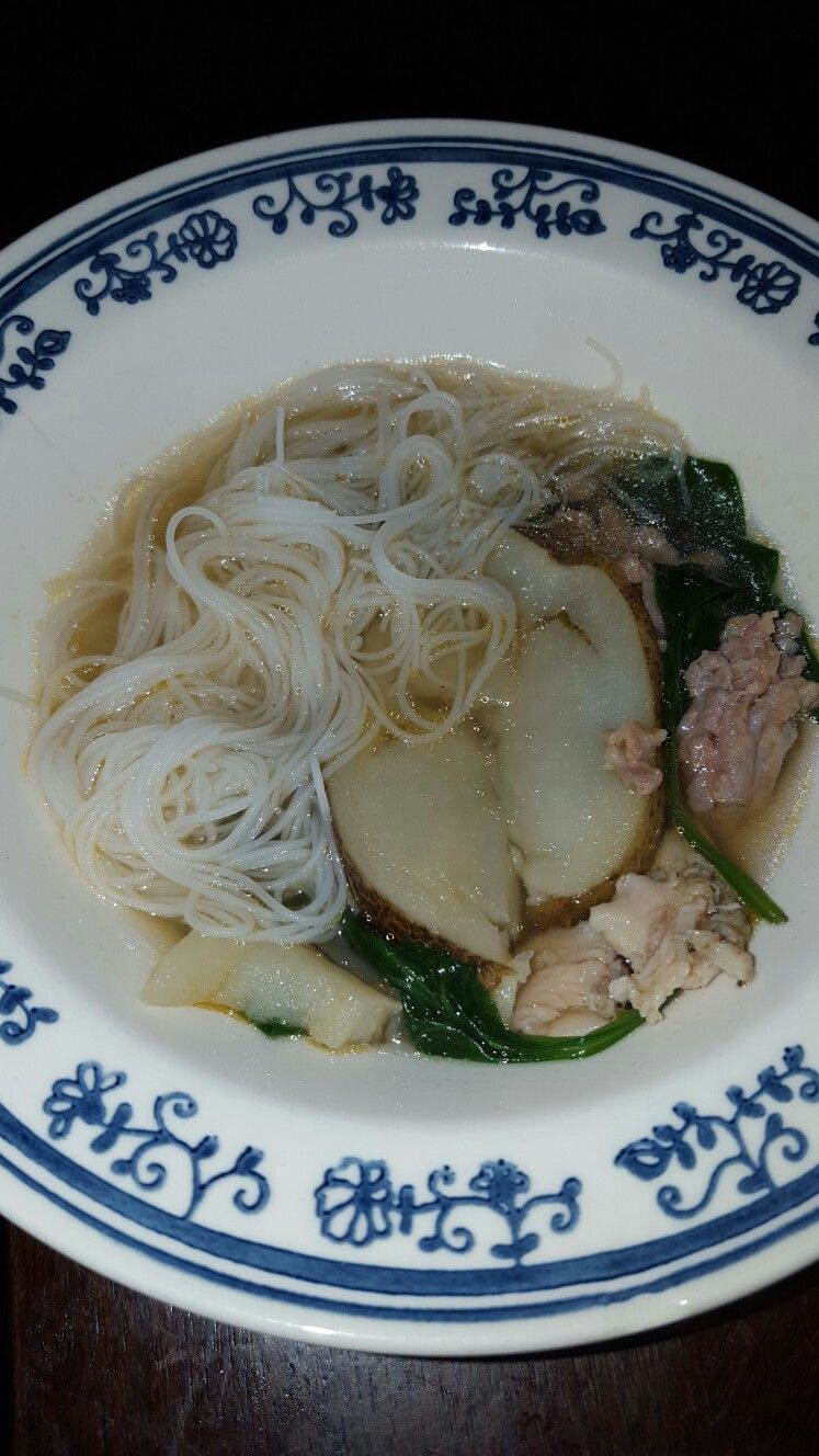 Rice noodle soup with chicken, pork and veggies