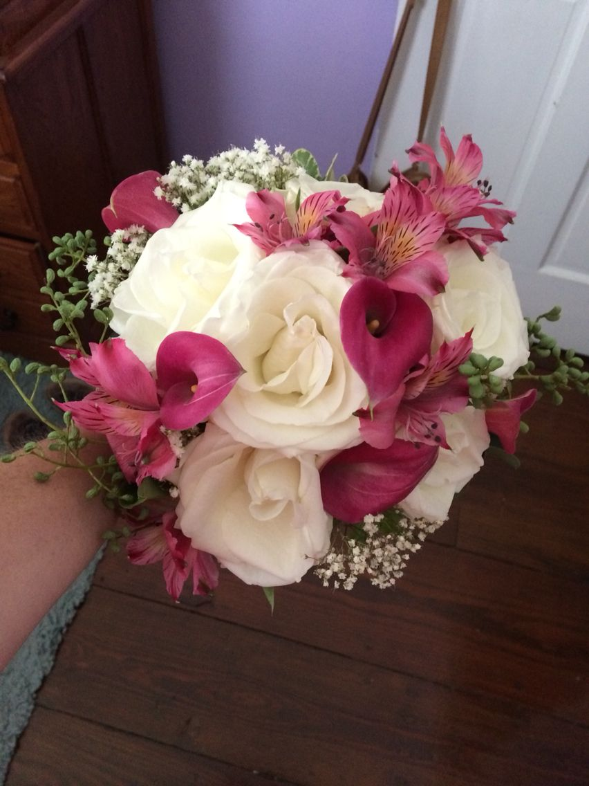 White rose, pink calla lily, astromeria, and seeded