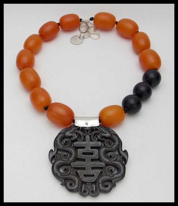 Beautiful hand carved 2 3/4 inch diameter Jade pendant with handforged pewter bail hangs from necklace made of handmade amber resin and