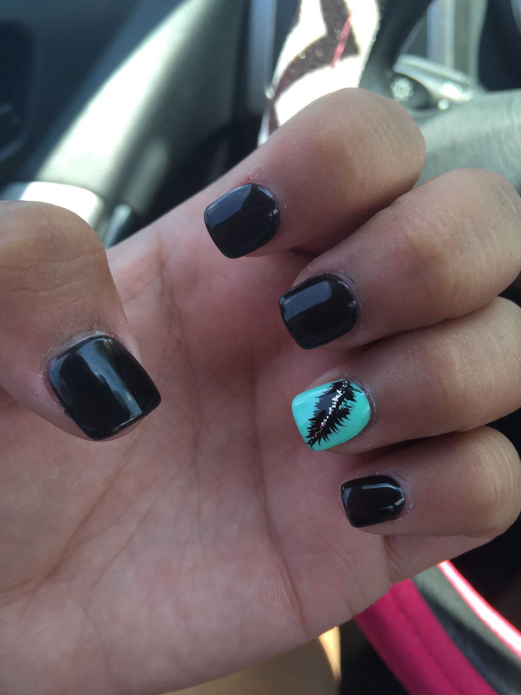 black nails with sea foam green ring finger with a feather. love