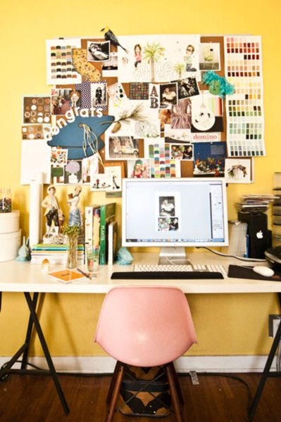 There's lots of visual inspiration to gaze upon over Gwendolyn of Dear Hancock's desk. The bright yellow wall and pink Eames chair are the picture of colorful simplicity.  (via Design*Sponge)
