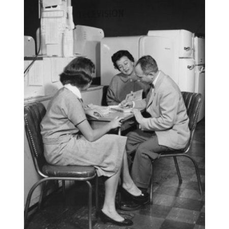 Side profile of a salesman sitting with two female customers in a store Canvas Art - (24 x 36)