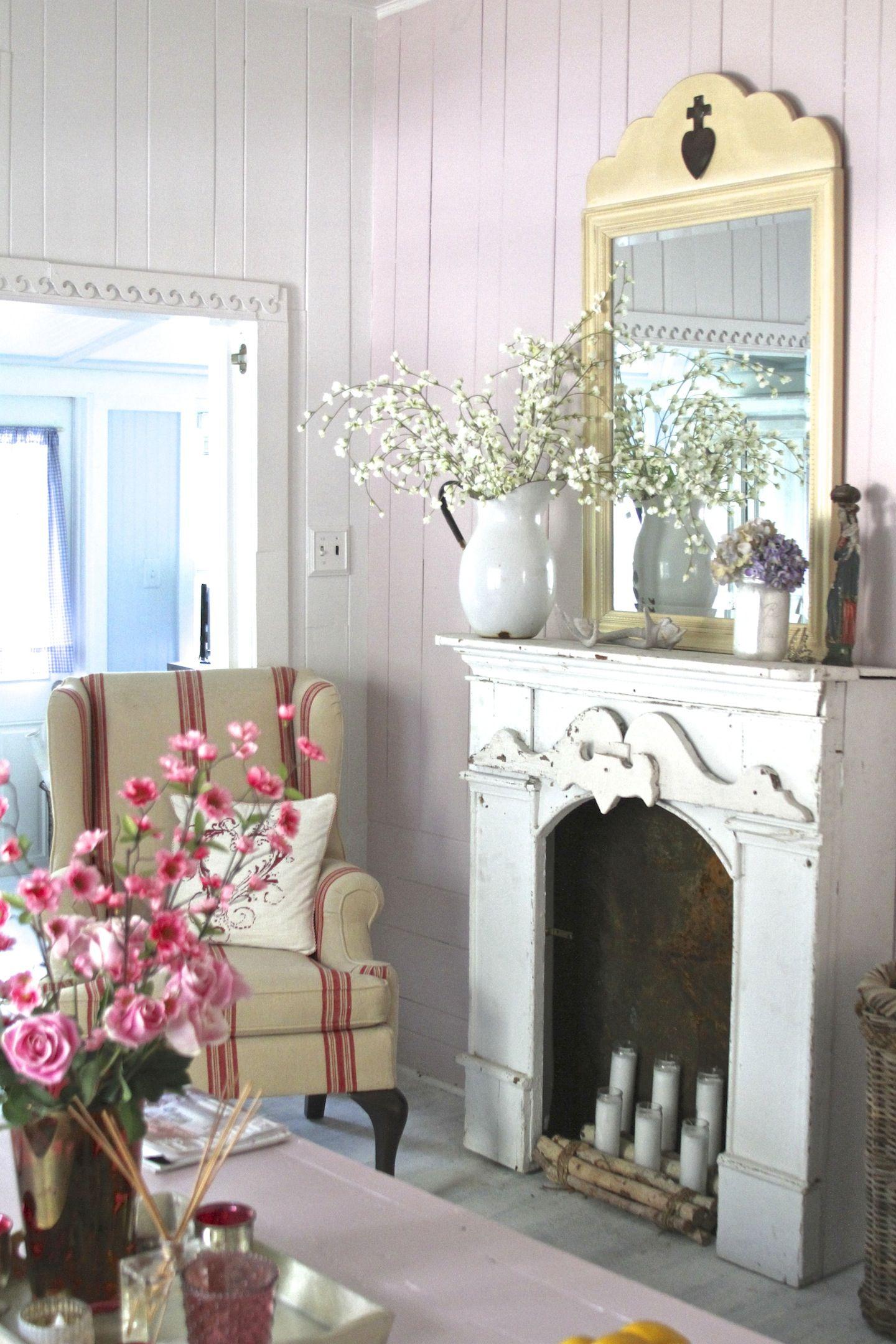 fireplace mantel,mirror, pitcher, ticking armchair