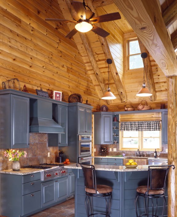 Log Home Kitchen With Colorful Cabinets