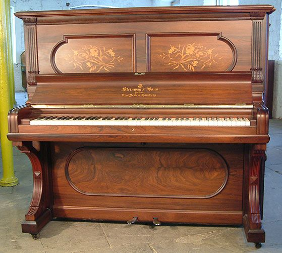 An 1896 Steinway Upright Piano With A Rosewood Case And