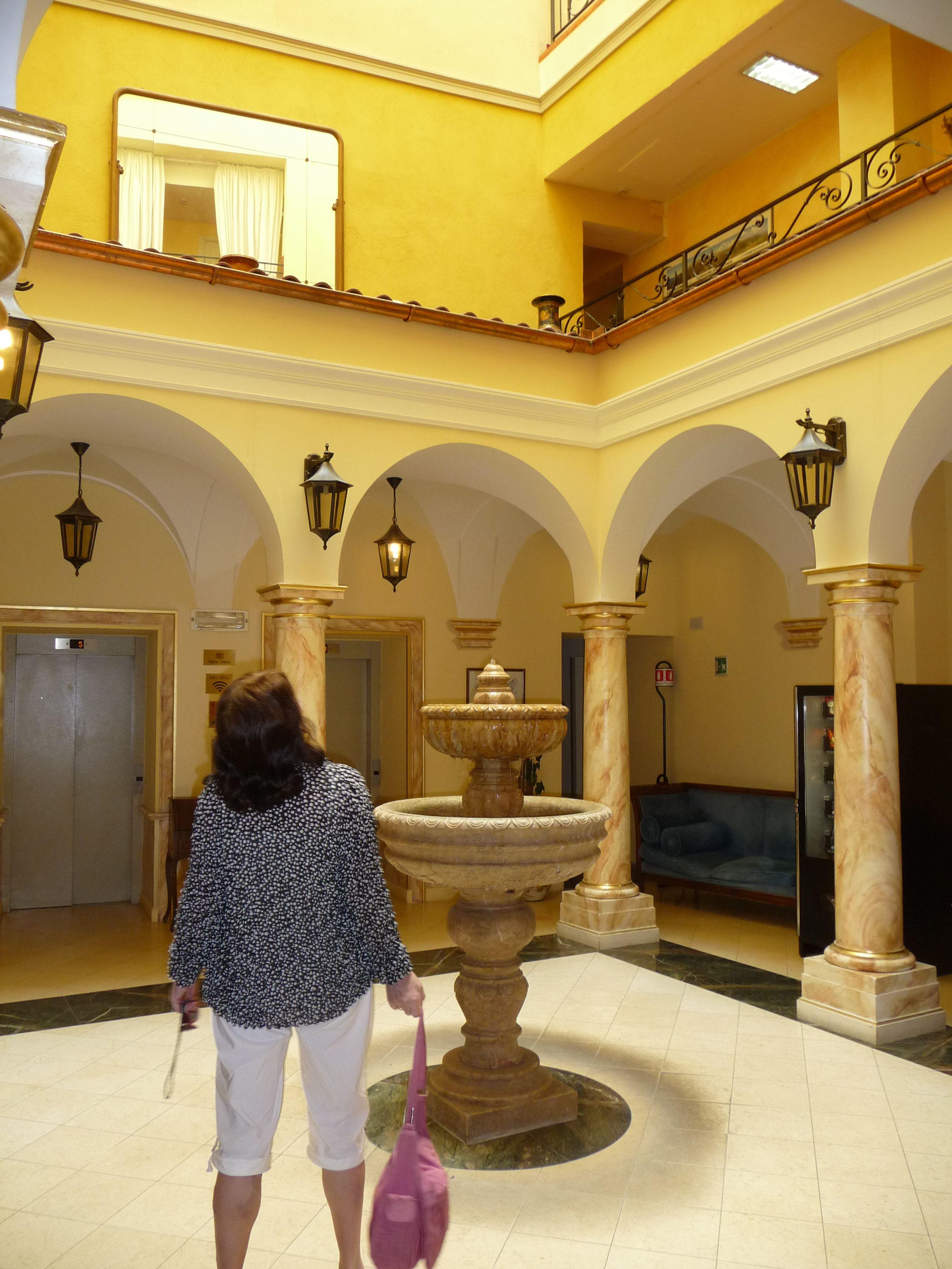 The Grand Britannia Excelsior hotel atrium. Lake Como, Italy.by B Waddington