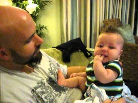 Baby's funny reaction to Dad's singing.