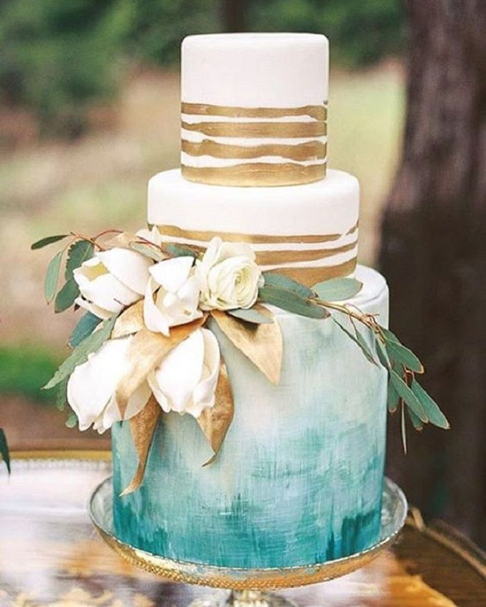 Painted Wedding Cake In Blue And Gold Wedding Cake With White Flowers
