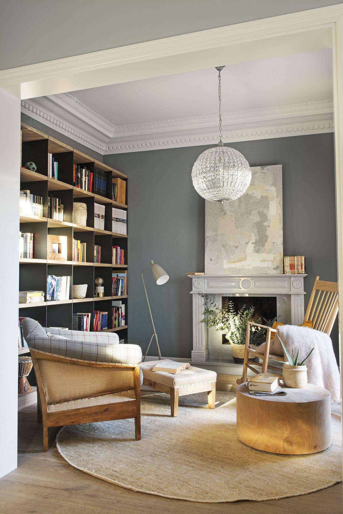 Una chimenea nost lgica en 2019 librer as salon con for Librerias salon modernas