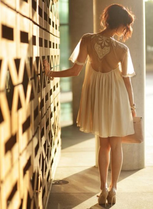 Love the sheer back on this light flowing dress.