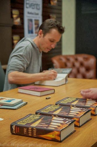 Markus Zusak signing copies of The Book Thief. Hey, umm... Do you think I could have a copy? :)