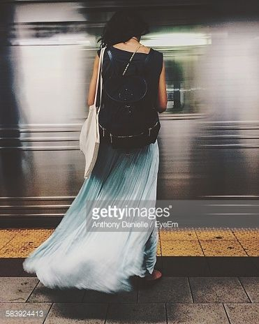 Foto stock : Rear View Of Woman Standing On Railroad Station Platform Against Moving Train