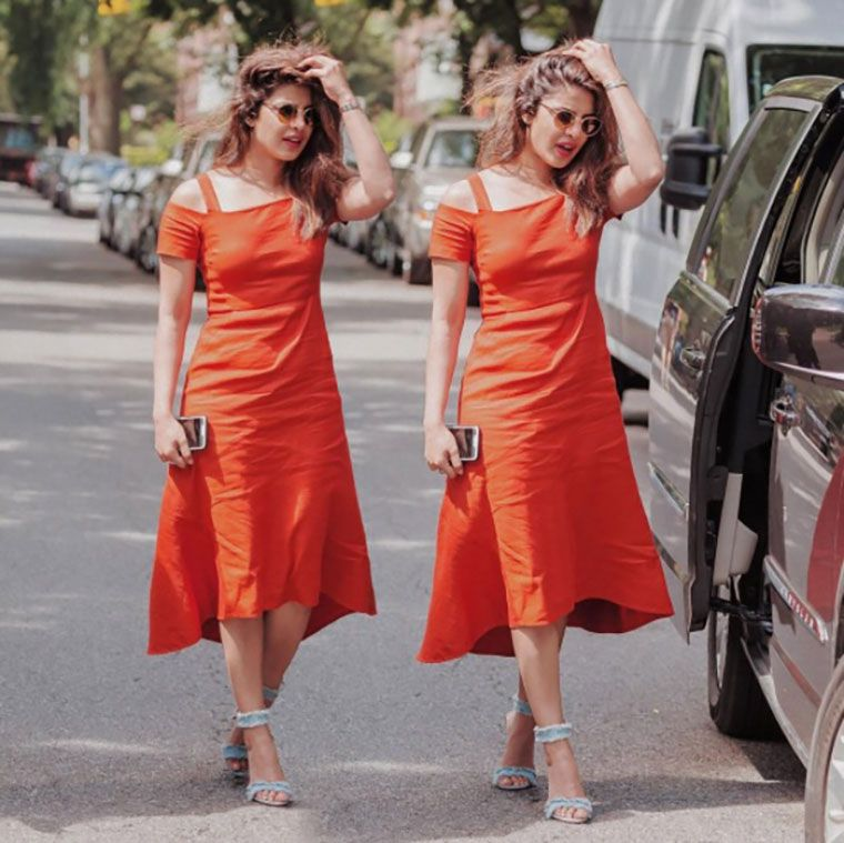 At another recent outing Peecee sported an off-shoulder midi dress in the same shade. She teamed it with denim-based heels from Gianvito Rossi. Priyanka Chopra's all-tangerine wardrobe has inspired our latest edit