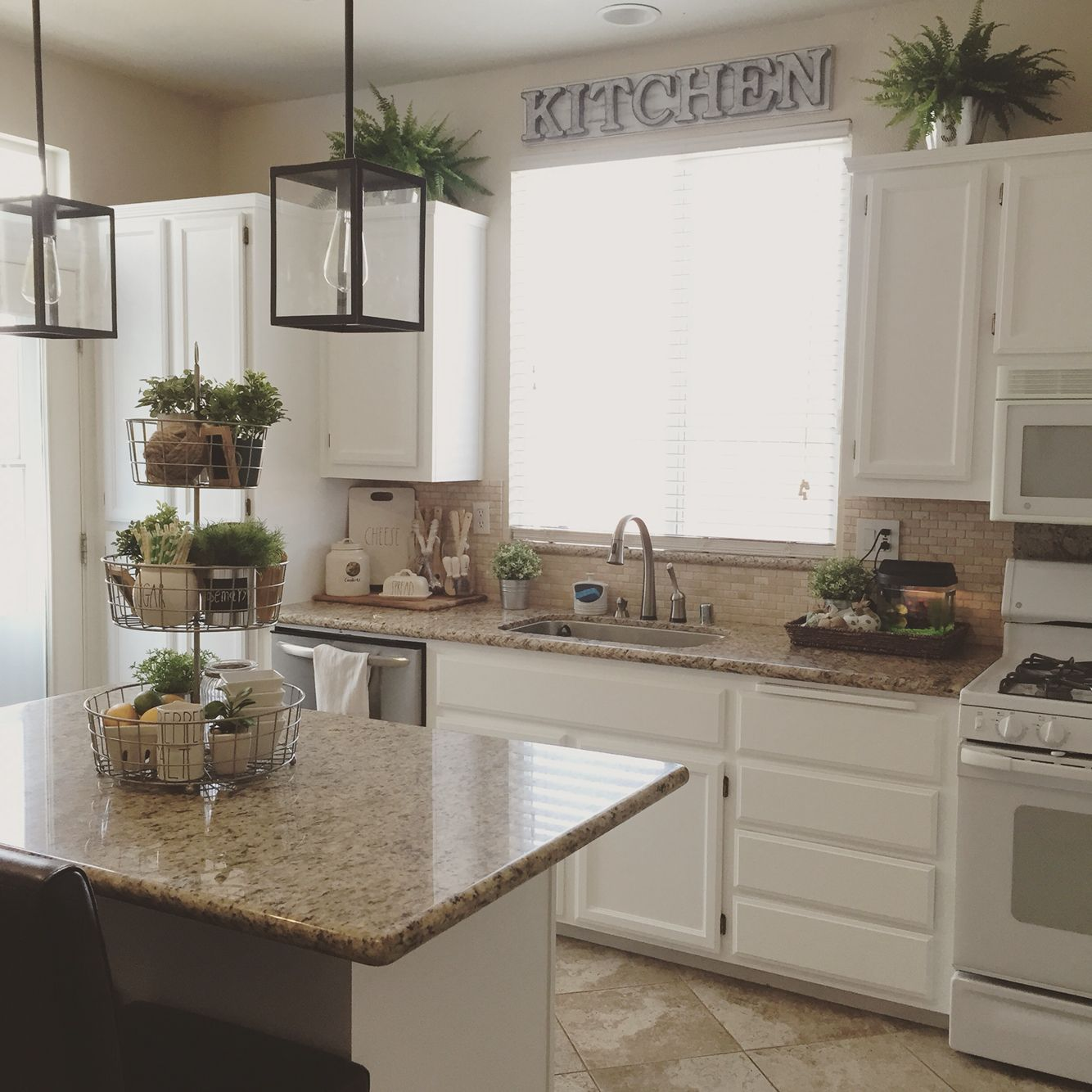 Farmhouse kitchen.   Decorating above kitchen cabinets ...