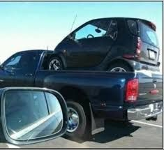 I Saw A Blue Dodge Ram Truck With Smart Car In The Bed Tooooo Funny