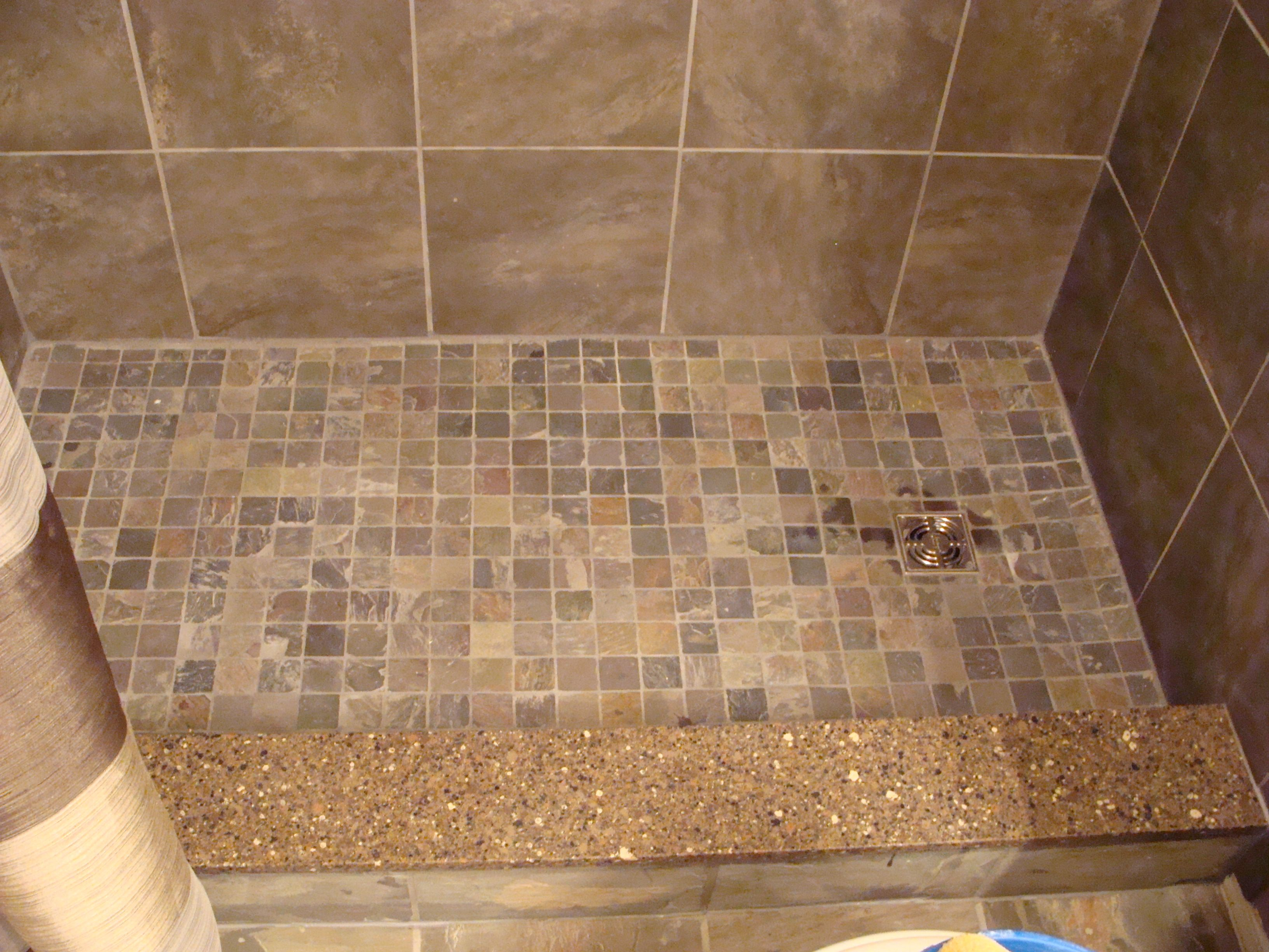 Slate mosaic tiles on shower floor quartz shower curb Bathroom tile ideas mosaic