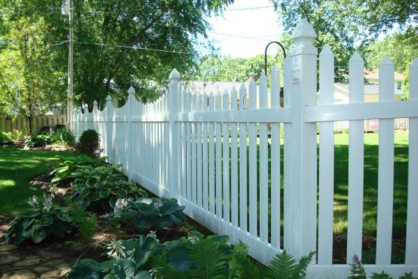 Tall White Picket Fence This 48 Tall White Prescott Picket Fence Defines The Property Line Farmhouse Landscaping Fence White Picket Fence
