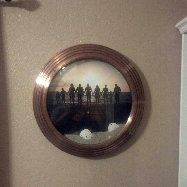 Took an old clock apart and put a photo in of family from the beach, then put sand, sand dollars and shells inside. Clock looks small in picture but picture is 18 inches across.