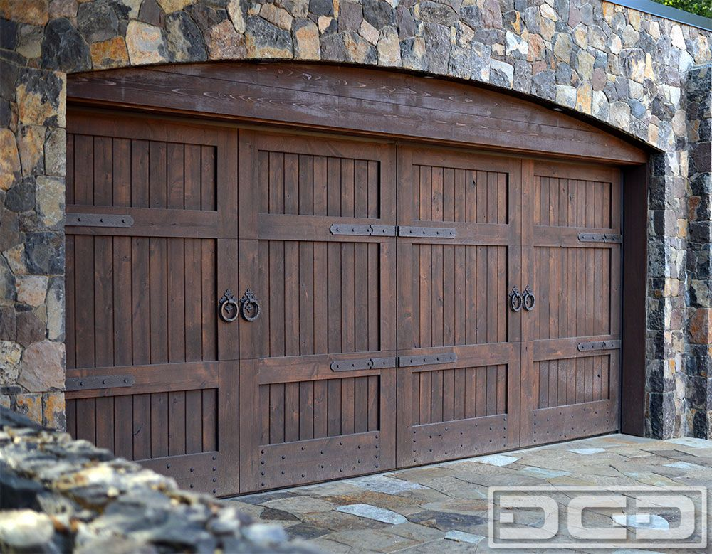 This tuscan style garage door was handcrafted in solid for The style garage