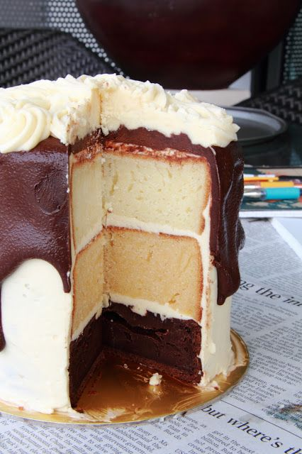 A gorgeous layer cake made of chocolate, caramel and white ...