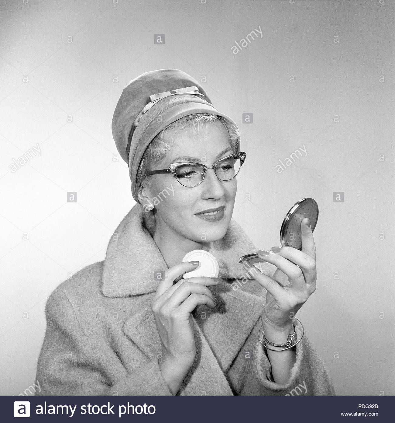 Download this stock image 1950s makeup. A young woman is
