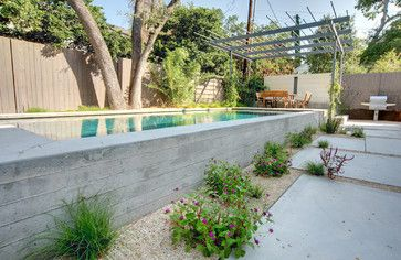A Private Getaway Isn T Really Private If The Neighbors Can See You Creating Some Sort Concrete Swimming Pool Pool Landscape Design Backyard Pool Landscaping