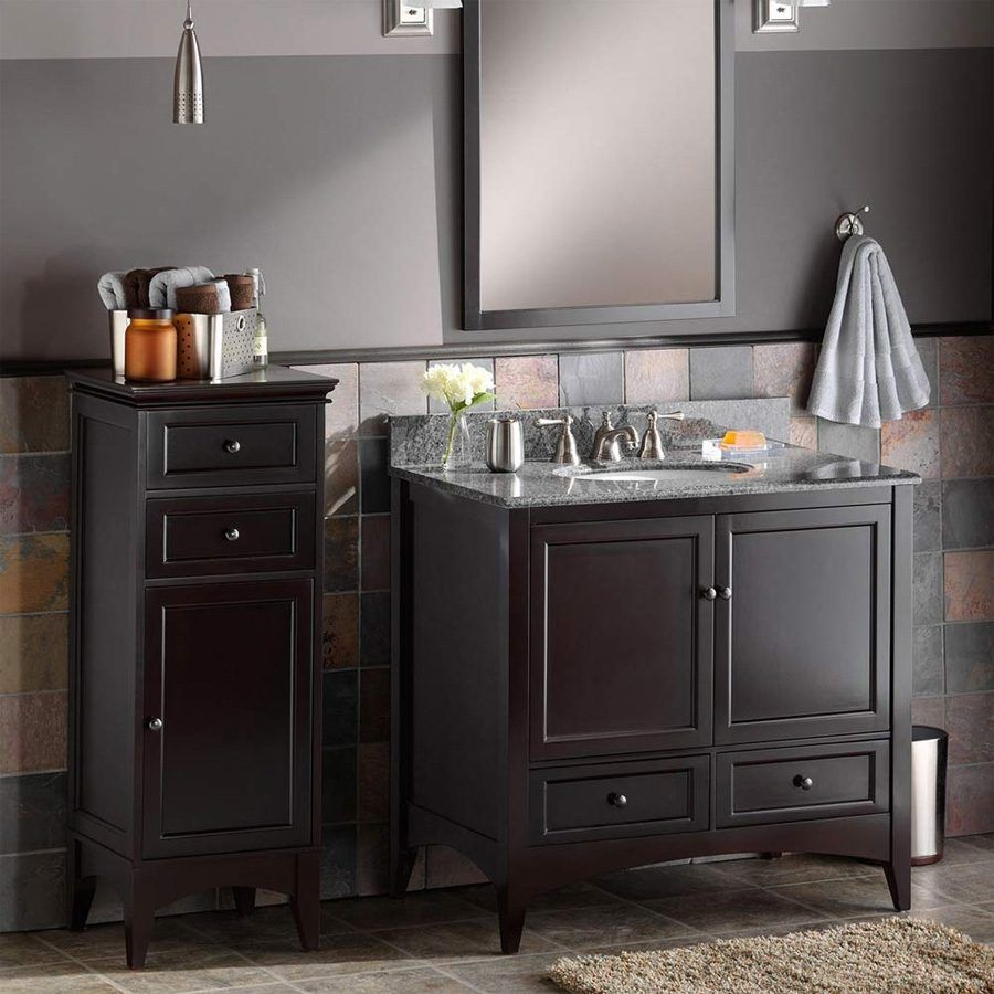 bathroom white cabinets dark floor