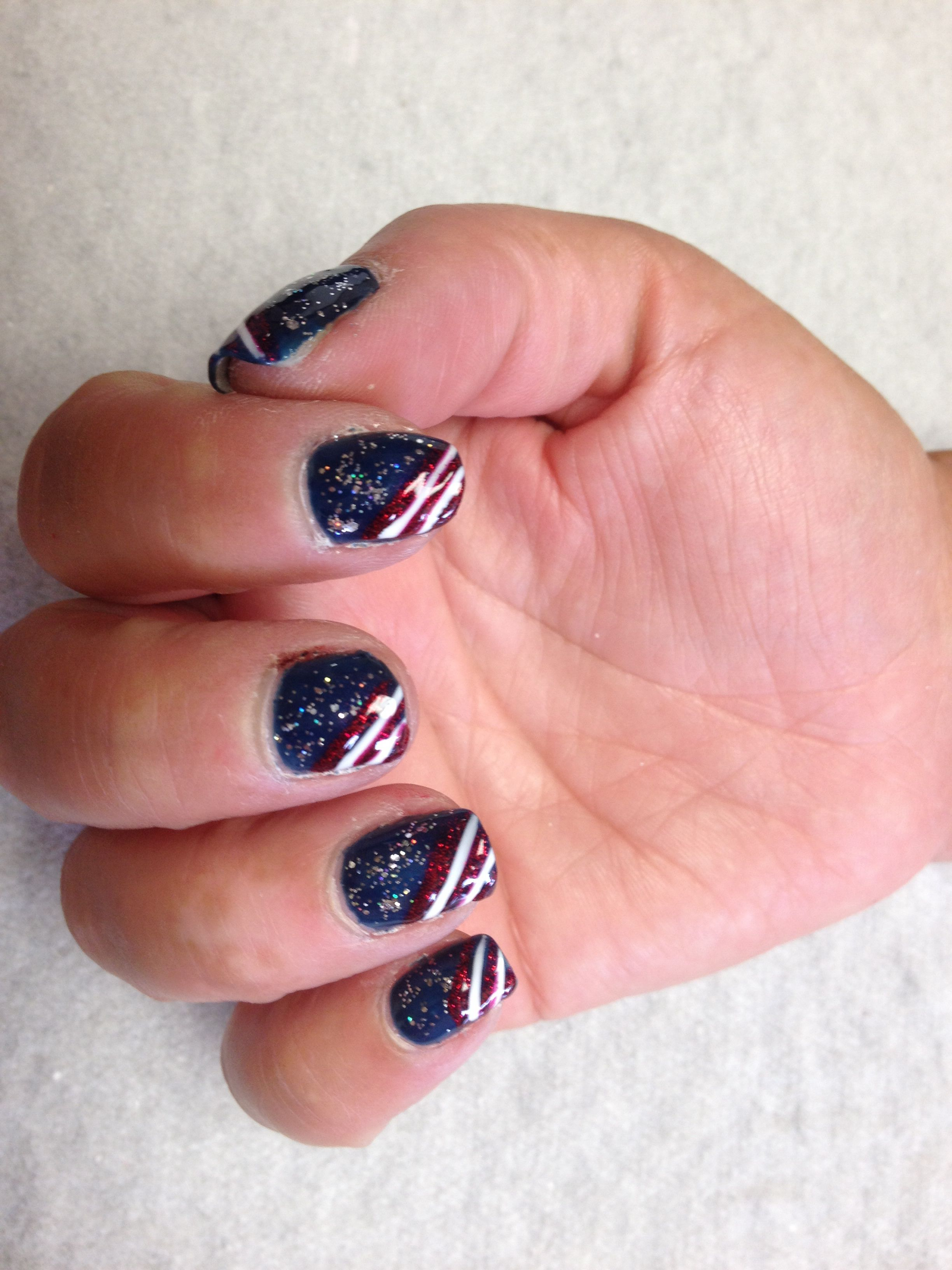 Blue with silver sparkles and red and white diagonal stripes  Oasis Salon and Spa Mill Hall Pa (570)726-6565