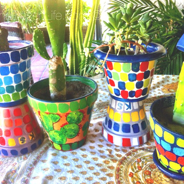 I'm painting pots with mosaic tile designs! Fun!